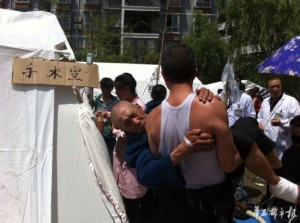 A man carries his father to medical facilities set up after the earthquake in Sichuan Province, China.